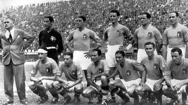 The Italians line-up with their coach Vittorio Pozzo ahead of the semi-final against Austria.